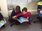 Year 3 and Nursery reading together