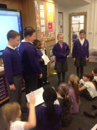 Year 5 children teach a maths lesson to Year 2
